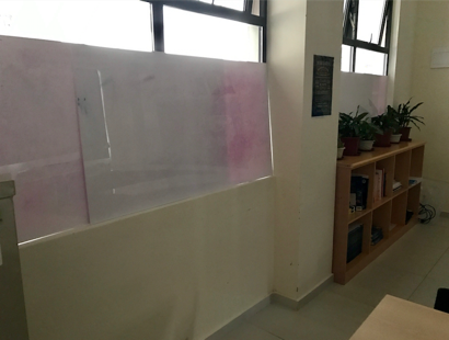 Lockdown:  Whiteboard table tops used to block the windows.